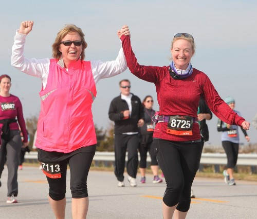 Lynn (in pink) and me (Kim) celebrating Lynn's triumph over a strained calf during the Across the Bay 10K