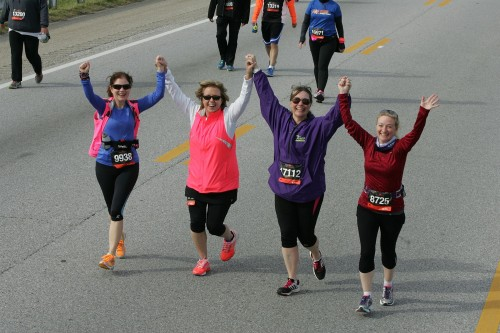 "Molly, in blue, embodies the ""community"" spirit of running – even in her race pictures!"