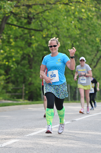 "Susan running the Rockstar 8k in 2013. ""We were told to 'be a rockstar if we saw a photographer,' so I rocked out with a little air guitar"""
